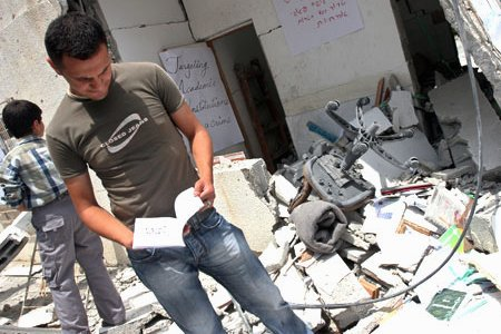 Students inspect the rubble of the Islamic University in Gaza. (MaanImages, Magnus Johansson)